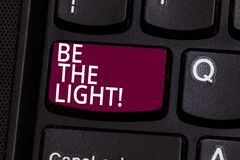 Word writing text Be The Light. Business concept for Enlighten other showing with your attitude be optimistic Keyboard. Key Intention to create computer message royalty free stock photography