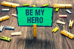Word writing text Be My Hero. Business concept for Request by someone to get some efforts of heroic actions for him Clothespin hol. Ding green paper note several royalty free stock photo