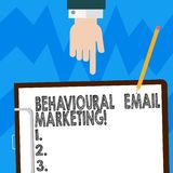 Word writing text Behavioural Email Marketing. Business concept for customercentric trigger base messaging strategy Hu analysis. Hand Pointing Down to Clipboard stock images