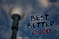 Word writing text Best Better Good. Business concept for improve yourself Choosing best choice Deciding Improvement Light post blu. E cloudy clouds sky ideas royalty free stock image