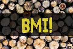 Word writing text Bmi. Business concept for Body Mass Index determines healthy weight range with respect to height royalty free stock image