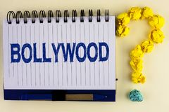Word writing text Bollywood. Business concept for Indian cinema a source of entertainment written on Notebook Book on the plain ba. Word writing text Bollywood Royalty Free Stock Photos