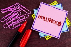 Word writing text Bollywood. Business concept for Indian cinema a source of entertainment written on Pink Sticky Note Paper on woo. Word writing text Bollywood stock photography