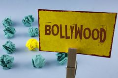 Word writing text Bollywood. Business concept for Indian cinema a source of entertainment written on Yellow Sticky Note Paper in C. Word writing text Bollywood Stock Photo