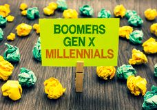 Word writing text Boomers Gen X Millennials. Business concept for generally considered to be about thirty years Clothespin holding. Yellow note paper crumpled royalty free stock photos