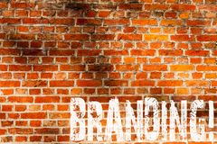 Word writing text Branding. Business concept for Creating a unique identity for startup agencies Brick Wall art like Graffiti. Motivational call written on the stock photos