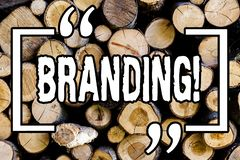 Word writing text Branding. Business concept for Creating a unique identity for startup agencies Wooden background vintage wood. Wild message ideas intentions stock photography