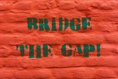 Word writing text Bridge The Gap. Business concept for Overcome the obstacles Challenge Courage Empowerment Brick Wall royalty free stock photos