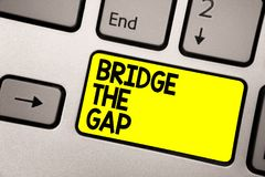 Word writing text Bridge The Gap. Business concept for Overcome the obstacles Challenge Courage Empowerment Keyboard yellow key In stock image
