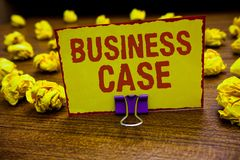 Word writing text Business Case. Business concept for Proposition Undertaking Verbal Presentation New Task Clip holding yellow pap. Er note crumpled papers royalty free stock photo