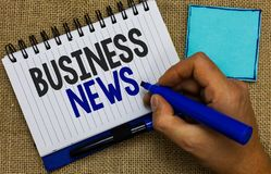 Word writing text Business News. Business concept for Commercial Notice Trade Report Market Update Corporate Insight Man holding m. Arker notebook page reminder royalty free stock photos