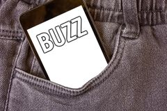 Word writing text Buzz. Business concept for Hum Murmur Drone Fizz Ring Sibilation Whir Alarm Beep Chime Cell phone jean pocket wh. Ite screen message stock image