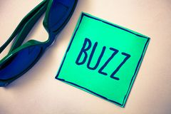 Word writing text Buzz. Business concept for Hum Murmur Drone Fizz Ring Sibilation Whir Alarm Beep Chime Green paper beige backgro. Und sunglasses ideas messages royalty free stock images