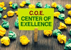 Word writing text C.O.E Center Of Excellence. Business concept for being alpha leader in your position Achieve Clothespin holding royalty free stock images