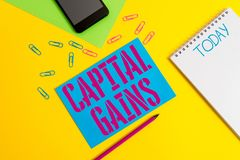 Word writing text Capital Gains. Business concept for Bonds Shares Stocks Profit Income Tax Investment Funds Blank spiral notepad