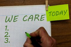 Word writing text We Care. Business concept for Care taken to prevent any problems and issues Caring Prevention Man. Holding marker notebook clothespin hold stock image