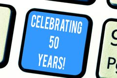 Word writing text Celebrating 50 Years. Business concept for Golden Anniversary Commemorating a special day Keyboard key. Intention to create computer message stock photo