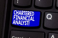 Word writing text Chartered Financial Analyst. Business concept for Investment and financial professionals Keyboard key. Intention to create computer message royalty free stock photo