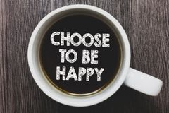 Word writing text Choose To Be Happy. Business concept for Decide being in a good mood smiley cheerful glad enjoy Black coffee wit. H coffee mug floating texts royalty free stock images