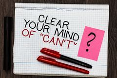 Word writing text Clear Your Mind Of Can t not. Business concept for Have a positive attitude thinking motivation Color pen on wri. Tten notepad with question Stock Image