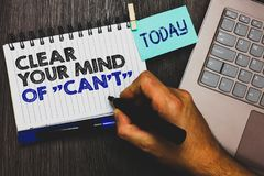 Word writing text Clear Your Mind Of Can t not. Business concept for Have a positive attitude thinking motivation Paperclip grip s. Ticky note with text hand Stock Photography