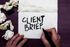 Word writing text Client Brief. Business concept for A documents bounded by the terms of clients and the agency Man holding marker. Notebook page crumpled royalty free stock photo