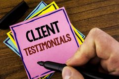 Word writing text Client Testimonials. Business concept for Customer Personal Experiences Reviews Opinions Feedback written by Man. Pink sticky note paper Royalty Free Stock Photos