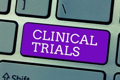 Word writing text Clinical Trials. Business concept for Research investigation to new treatments to showing.  stock photos