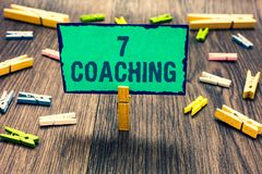 Word writing text 7 Coaching. Business concept for Refers to a number of figures regarding business to be succesful Clothespin hol. Ding green paper note several royalty free stock photography