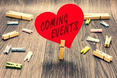 Word writing text Coming Events. Business concept for Happening soon Forthcoming Planned meet Upcoming In the Future Clothespin ho. Lding red paper heart several Royalty Free Stock Photography