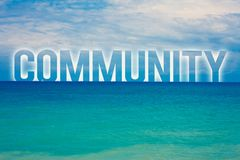 Word writing text Community. Business concept for Neighborhood Association State Affiliation Alliance Unity Group Blue beach water. Cloudy clouds sky natural Stock Photo