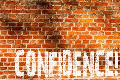 Word writing text Confidence. Business concept for Never ever doubting your worth,inspire and transform yourself Brick Wall art. Like Graffiti motivational call royalty free stock photos