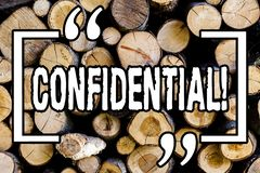 Word writing text Confidential. Business concept for Agreements between two parties are private and protected Wooden background. Vintage wood wild message ideas royalty free stock photos