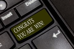 Word writing text Congrats You Are Win. Business concept for Congratulations for your accomplish competition winner. Keyboard key Intention to create computer royalty free stock images