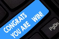 Word writing text Congrats You Are Win. Business concept for Congratulations for your accomplish competition winner. Keyboard key Intention to create computer stock photography