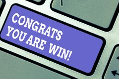 Word writing text Congrats You Are Win. Business concept for Congratulations for your accomplish competition winner. Keyboard key Intention to create computer stock image