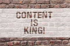 Word writing text Content Is King. Business concept for Content is the heart of todays marketing strategies Brick Wall. Art like Graffiti motivational call royalty free stock images