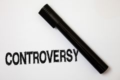 Word writing text Controversy. Business concept for Disagreement or Argument about something important to people Ideas messages wh. Ite background black marker Stock Images