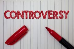 Word writing text Controversy. Business concept for Disagreement or Argument about something important to people Notebook paper ba. Ckground open marker ideas Royalty Free Stock Photo