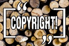 Word writing text Copyright. Business concept for Saying no to intellectual property piracy Wooden background vintage wood wild. Message ideas intentions stock photography
