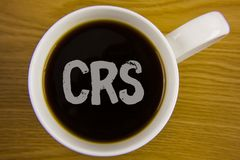 Word writing text Crs. Business concept for Common reporting standard for sharing tax financial information written on Black Tea i. Word writing text Crs Stock Photos