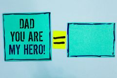 Word writing text Dad You Are My Hero. Business concept for Admiration for your father love feelings compliment Black lined green. Sticky notes blank and with stock photography