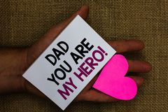 Word writing text Dad You Are My Hero. Business concept for Admiration for your father love feelings compliment Human hand touched stock photo