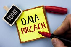 Word writing text Data Breach. Business concept for Stolen Cybercrime Information Hacking Security Malicious Crack written by Man. Holding Marker Sticky Note Royalty Free Stock Photo
