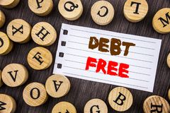 Word, writing, text  Debt Free. Conceptual photo Credit Money Financial Sign Freedom From Loan Mortage written on tear notobook pa. Per on wooden background with Royalty Free Stock Photography
