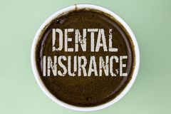 Word writing text Dental Insurance. Business concept for Dentist healthcare provision coverage plans claims benefit written on Cof. Word writing text Dental Royalty Free Stock Photography