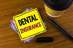 Word writing text Dental Insurance. Business concept for Dentist healthcare provision coverage plans claims benefit written on Sti. Word writing text Dental Stock Photos