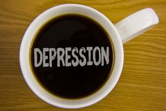 Word writing text Depression. Business concept for Work stress with sleepless nights having anxiety disorder written on Black Tea. Word writing text Depression stock photo