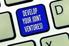 Word writing text Develop Your Joint Ventures. Business concept for Business partnership cooperation growing Keyboard. Key Intention to create computer message stock photos