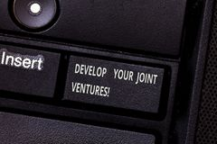 Word writing text Develop Your Joint Ventures. Business concept for Business partnership cooperation growing Keyboard. Key Intention to create computer message royalty free stock photos